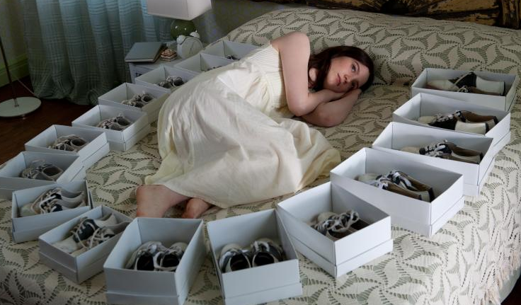 Above: India Stoker, surrounded by shoes: an identical pair for every birthday. Her secret gift-giver doesn't have much in the way of fashion sense.